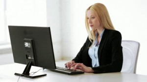 stock-footage-attractive-business-woman-working-with-computer-in-office